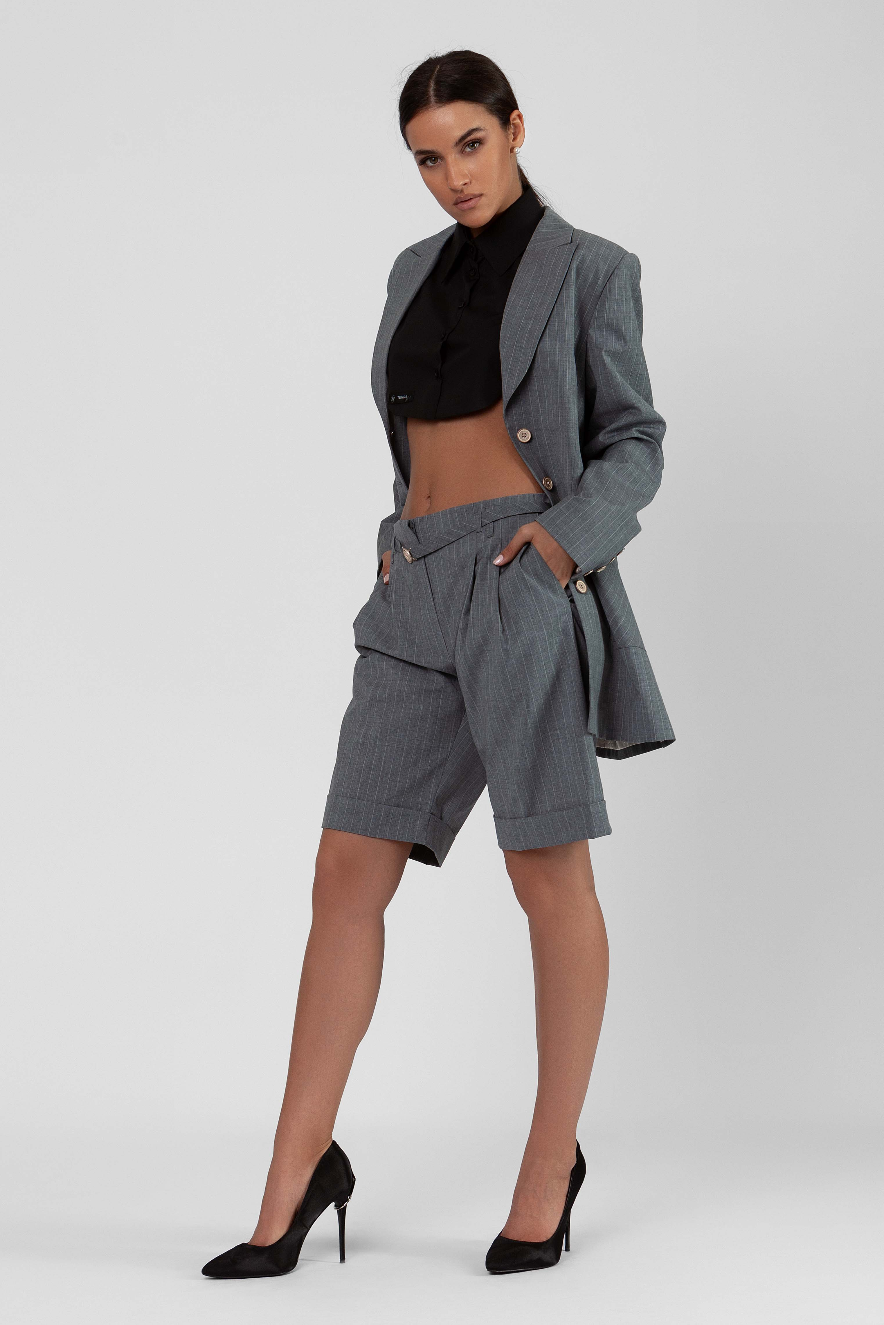 man influenced suit with short pants